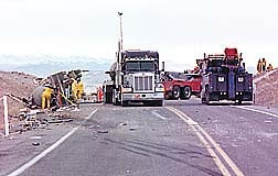 Hazardous materials crews work to empty diesel from an overturned truck after it collided with another vehicle two miles north of Wabuska on Highway 95A on February 20, 2001. The tanker contained sulfuric acid, none of which spilled yet closed the highway for about nine hours. - Nevada Appeal Photo