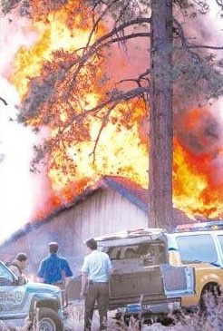A house on Old Cold Creek is fully engulfed in flames on October 24, 2001 during a blaze of unknown origin. The fire did not spread to the surrounding forest, but the home was completely destroyed. The 4,000 square-foot retirement home was built in 1996.  Photo credit – Rick Gunn/Nevada Appeal