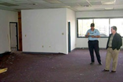 Fire Inspector Duane Lemons inspects a building under renovation for fire safety standards. CCFD photo.
