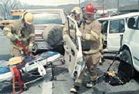 Firefighters at the scene of a motor vehicle accident, March 22, 2001.