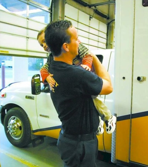 Carson City firefighter Bryon Hunt hugs his 3-year-old son Tyler after returning from an emergency call at Carson City Fire Station No. 1 on December 25, 2006.  Hunt, who worked a 48-hour shift over the holidays, was spending part of Christmas day with his family at the fire station.  Photo credit - Brad Horn/Nevada Appeal