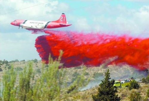 Click to enlarge - An airtanker drops slurry on the Sedge Fire in the Brunswick Canyon bridge area on the east side of Carson City on Wednesday.  The fire burned 10 acres and was 100 percent contained by 5 p.m.  Photo credit - Brad Horn/Nevada Appeal