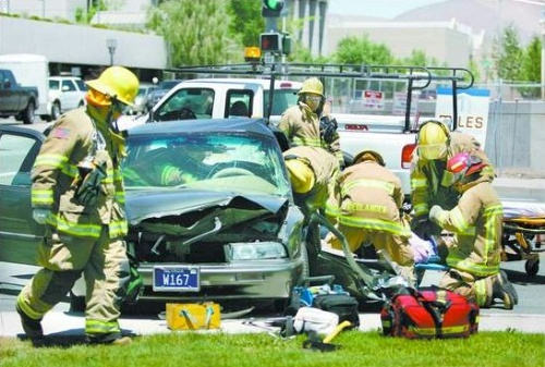 Click to enlarge - Carson City firefighters used the Jaws of Life to cut Molly Dondero, 59, out of her vehicle Thursday following an accident at Stewart and Fifth streets.  She was taken by helicopter to a Reno hospital.  Photo credit - Cathleen Allison/Nevada Appeal