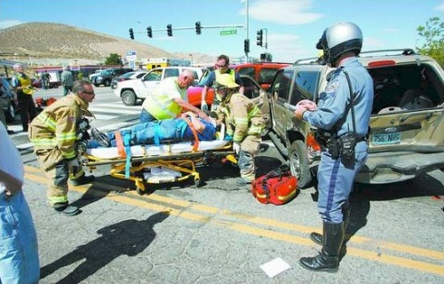 Click to enlarge - Firefighters transported several people to area hospitals following a six-car accident at South Carson Street and Clearview Drive on Tuesday afternoon. The accident briefly closed South Carson Street and caused two people to be taken by Care Flight Helicopter because of their injuries.  Photo credit - Cathleen Allison/Nevada Appeal