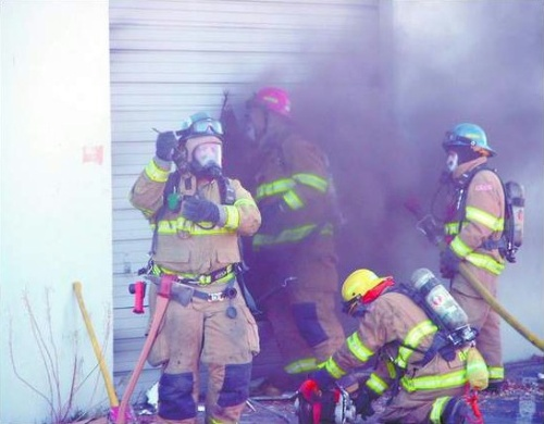 Firefighters attempt to gain entry to an industrial complex located at 900 Mallory Way Sunday, December 2, 2007.   Photo credit - Adam Trumble/Nevada Appeal