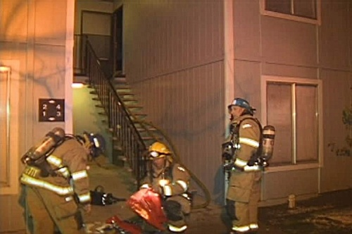 Click to enlarge - Carson City firefighters on scene of an apartment fire at 400 South Saliman on Saturday, December 8, 2007.  Photo credit - Dave Morgan/Newscarsoncity.com