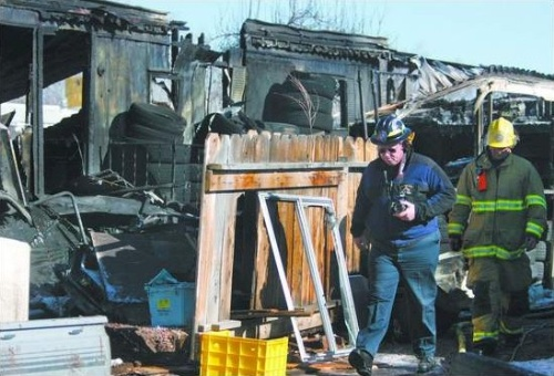 Carson City Fire Investigator Duane Lemons works on January 17, 2008 at a home on Star Way, where one person died in an early morning fire.  Photo credit - Cathleen Allision/Nevada Appeal