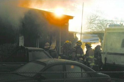 Carson City firefighters work at a fire at 2305 Star Way in northeast Carson City that killed at least one person on January 17, 2008.  Photo credit - Brad Horn/Nevada Appeal