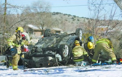 Click to enlarge - Carson City firefighters work on two accident victims on Deer Run Road on Thursday morning. Both were pronounced dead at the scene.  Photo credit - Cathleen Allison/Nevada Appeal.
