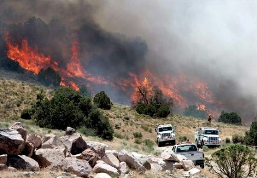 Crews battle the Flint fire July 1, 2006, on the east side of Carson City.  Photo credit - Chad Lundquist/Nevada Appeal.