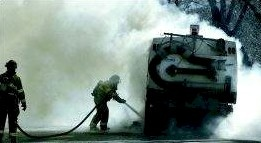 Carson City firefighters extinguish a fire in a street sweeper Monday afternoon near Sixth and Nevada streets.  Photo credit Cathleen Allison/Nevada Appeal