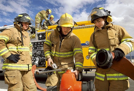 Firefighter Matt Merritt, center, instructs two volunteer firefighter trainees, February 24, 2004.  Photo credit Scott Sady/Reno Gazette-Journal