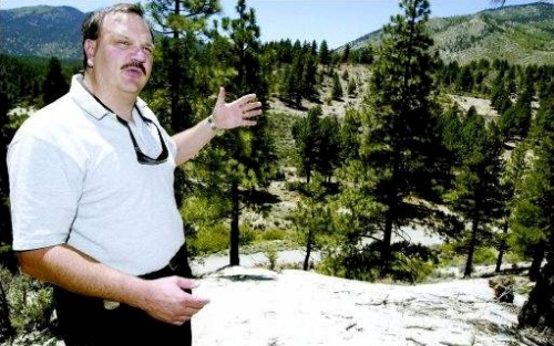 Carson City Fire Marshall Stacey Giomi talks about fire breaks on the hill behind him at the Arnold property on Clear Creek Road. The top of the hill has been cleared, while the middle still needs to be cleared for defensible space.  Photo credit Belinda Grant/Nevada Appeal