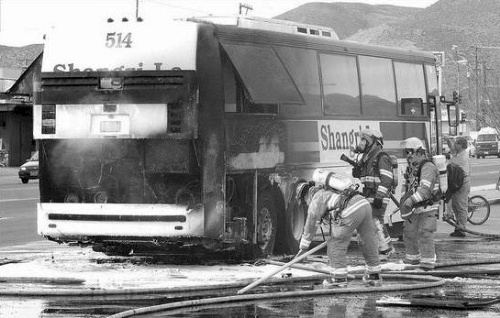 Click to enlarge - Firefighters were called when a tour bus caught fire in front of Grocery Outlet on North Carson Street on March 20, 2002. The flames from the engine engulfed the bus.