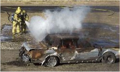 Click to enlarge - Firefighters get some hands on training December 11, 2002 with a simulated vehicle fire.  Photo credit Lisa J. Tolda, Reno Gazette-Journal.